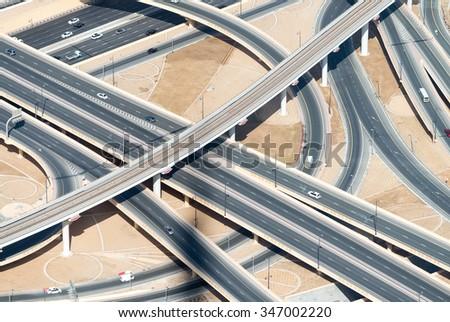 Aerial view of highway interchange of modern urban city. - stock photo