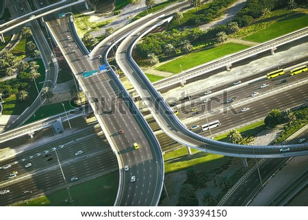 Aerial view of highway intersection in Dubai, UAE, with traffic. - stock photo