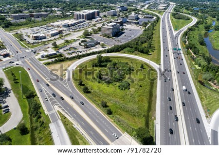 Aerial view of highways, surface streets, shopping centers and strip malls in the Chicago suburb of Northbrook, IL. USA