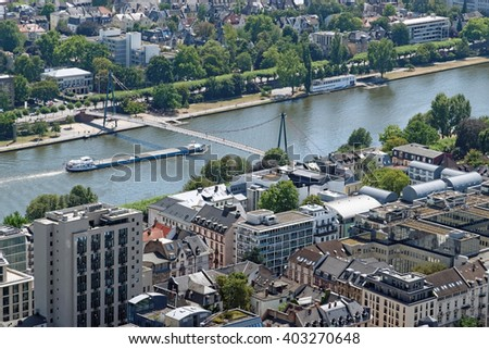 Aerial view of Holbeinsteg pedestrian suspension bridge over the river Main in Frankfurt am Main, Germany.  - stock photo