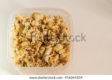 Aerial view of home made popcorn on isolated white background. - stock photo