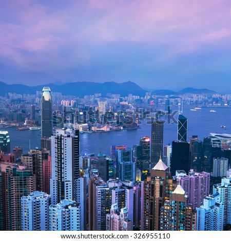 Aerial view of Hong Kong skyline and Victoria Harbor at sunset. Travel destinations - stock photo