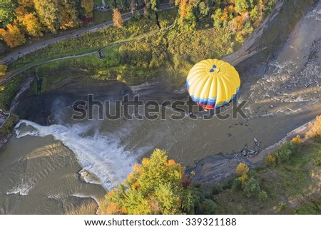 Aerial view of Hot Air Balloon flying over the Middle Falls at Letchworth State Park in New York - stock photo
