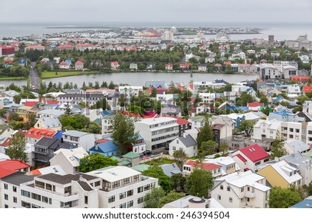 Aerial view of houses and lake in Reykjavik, Iceland - stock photo