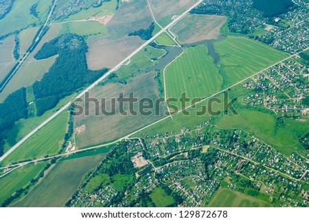 Aerial view of houses and suburban streets in autumn - stock photo