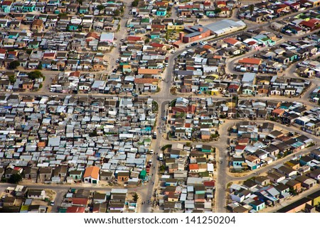 Aerial view of informal settlements of the Cape Flats, Cape Town, South Africa - stock photo