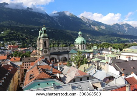 Aerial view of Innsbruck city taken from City Tower (Stadtturm) which was built in 1450 in Tirol, Austria. With 51 meters of height, City Tower is located in Old City (Altstadt or Altestadt). - stock photo