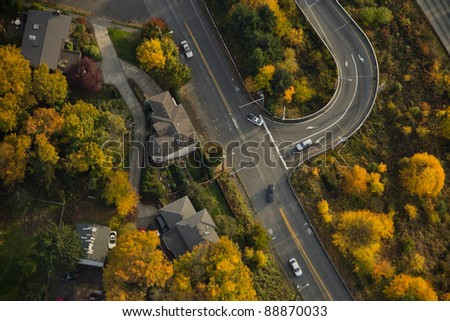 Aerial view of interstate exit surrounded by yellow trees - stock photo