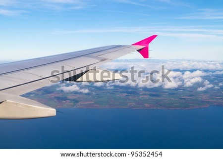 Aerial view of Ireland with plane wing