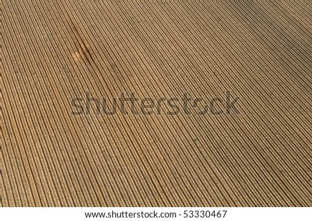 Aerial View of Israel countryside , Plowed Field ploughed in a row. - stock photo