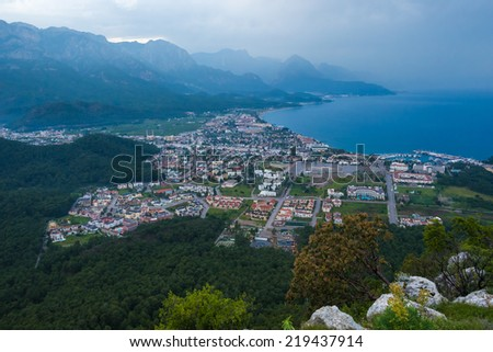 Aerial view of Kemer town with seashore and big mountains on a background. Antalya, Turkey. - stock photo