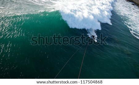 Aerial View of Kitesurfer Surfing a Big Wave - stock photo