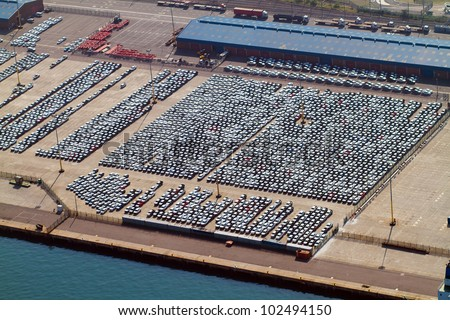 aerial view of large amount of automobiles parked at durban harbour, south africa - stock photo