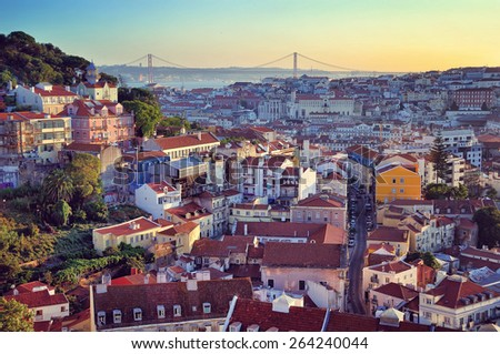 Aerial view of Lisbon, Portugal at sunset. Viewpoint Miradoura Da Graca - one of the best in the city and very popular among tourists. Bridge of 25 April at the background - stock photo