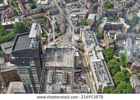 Aerial view of London with construction cranes - stock photo