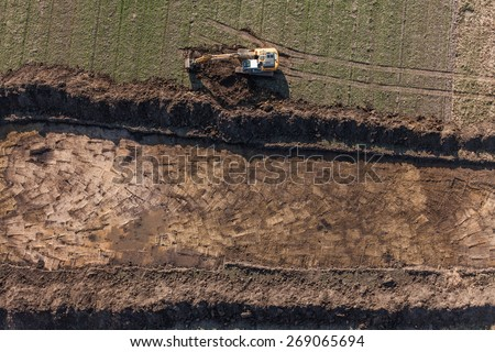 aerial view of long arm excavator working on the field in Poland - stock photo