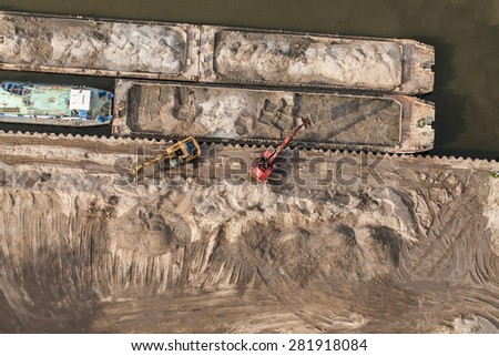 aerial view of long arm excavator working on the river bank in Poland - stock photo