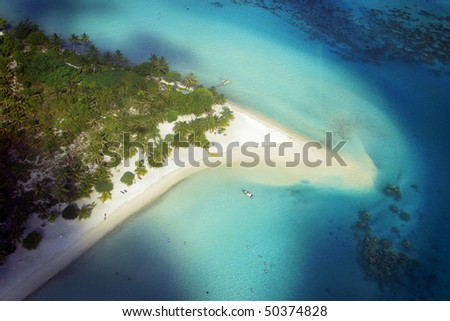 Aerial View of luxurious beach at Bora Bora, in the pacific Ocean. - stock photo