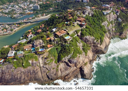 Aerial view of luxury homes perched on a cliffside in Rio De Janeiro - stock photo