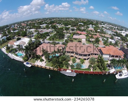 Aerial view of luxury waterfront homes in Florida - stock photo