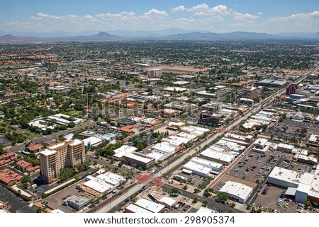 Aerial view of Main Street in downtown Mesa, Arizona with light rail transportation near completion - stock photo