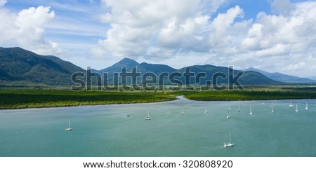 Aerial view of mangrove inlet and mountain range, Cairns, Queensland, Australia - stock photo