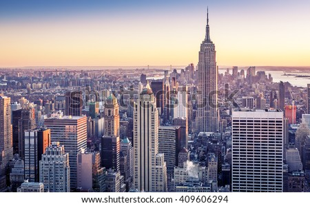 Aerial view of Manhattan in New York city, USA with its famous skyscrapers and light on a sunny sunset.