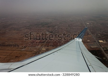 Aerial view of Marrakesh (with airplane wing), Morocco - stock photo