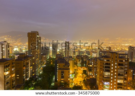 Aerial view of Medellin at night with residential buildings. Colombia 2015 - stock photo