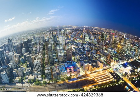 Aerial view of Melbourne, fading from day to night - stock photo