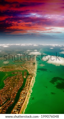 Aerial view of Miami Beach. Ocean and cityscape at dusk. - stock photo