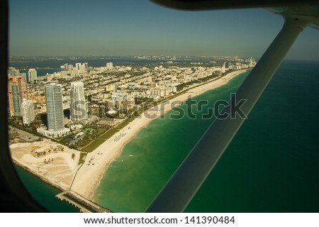 Aerial view of Miami beach viewed from window of airplane, Florida, U.S.A. - stock photo