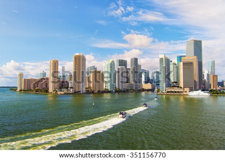 Aerial view of Miami downtown, boats sailing next to skyscrappers - stock photo