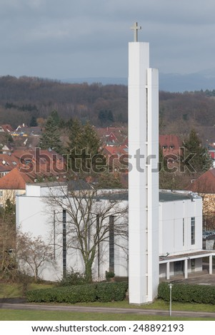 Aerial view of modern Freiburg Seepark church in front of the Black Forest, Germany