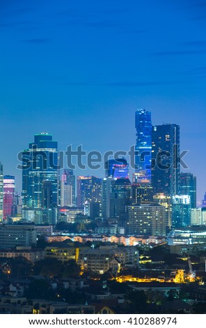 Aerial view of modern office buildings, condominium and hotel in Bangkok city downtown at night - stock photo