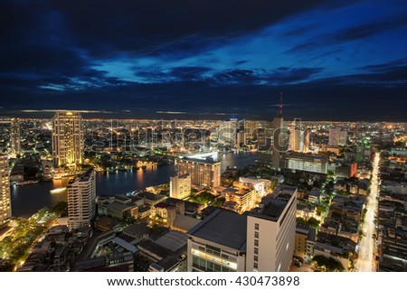Aerial view of modern office buildings, condominium in big city downtown at night - stock photo