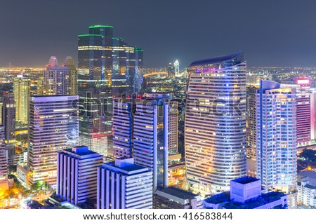 Aerial view of modern office buildings, condominium in big city downtown with night light - stock photo