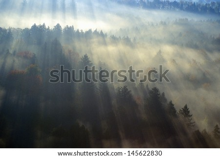 Aerial view of Morning fog and sunrise in autumn near Stowe, VT on Scenic Route 100 - stock photo