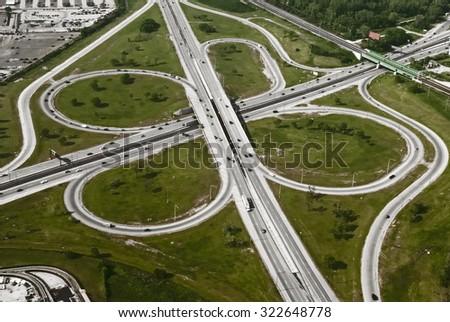 Aerial view of motorway freeway roads junction - stock photo