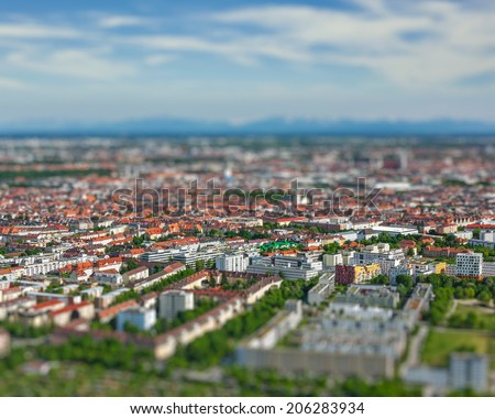 Aerial view of Munich from Olympiaturm (Olympic Tower). Munich, Bavaria, Germany with tilt shift toy effect shallow depth of field - stock photo