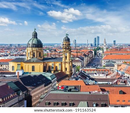 Aerial view of Munich over Theatine Church of St. Cajetan (Theatinerkirche St. Kajetan) and Odeonplatz, Munich, Bavaria, Germany - stock photo