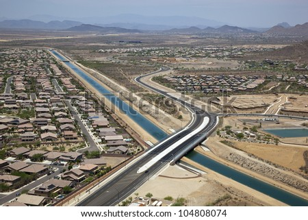 Aerial view of new bridge over Canal - stock photo