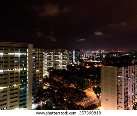 Aerial view of new estate, HDB housing complex with neighborhood faculties car park and green garden at the center at Eunos area of Singapore. Night view - stock photo