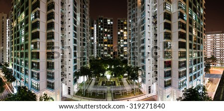 Aerial view of new estate with neighborhood faculties car park and green garden at the center at Eunos area of Singapore. Night view with Panoramic style - stock photo