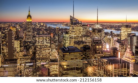 Aerial view of New York city in the USA at sunset showcasing its mix of Historic and modern skyscrapers that characterize its architecture world wide. - stock photo