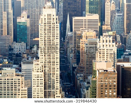 Aerial view of New York City with a view of Saint Patricks Church and the skyscrapers along Fifth Avenue - stock photo
