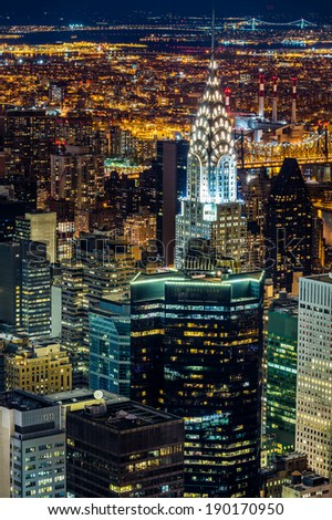 Aerial view of New York skyscrapers at night - stock photo