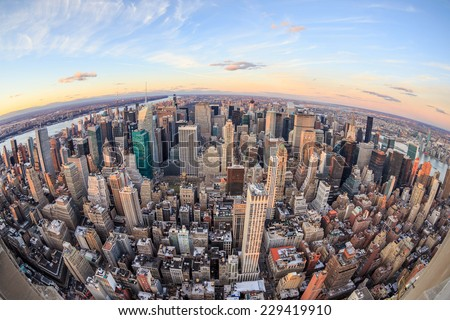 Aerial view of New York skyscrapers at sunset - stock photo