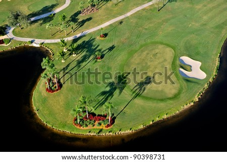 aerial view of nicely manicured florida golf green - stock photo
