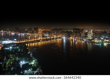 Aerial view of Nile river and bridge Cairo Egypt at night - stock photo